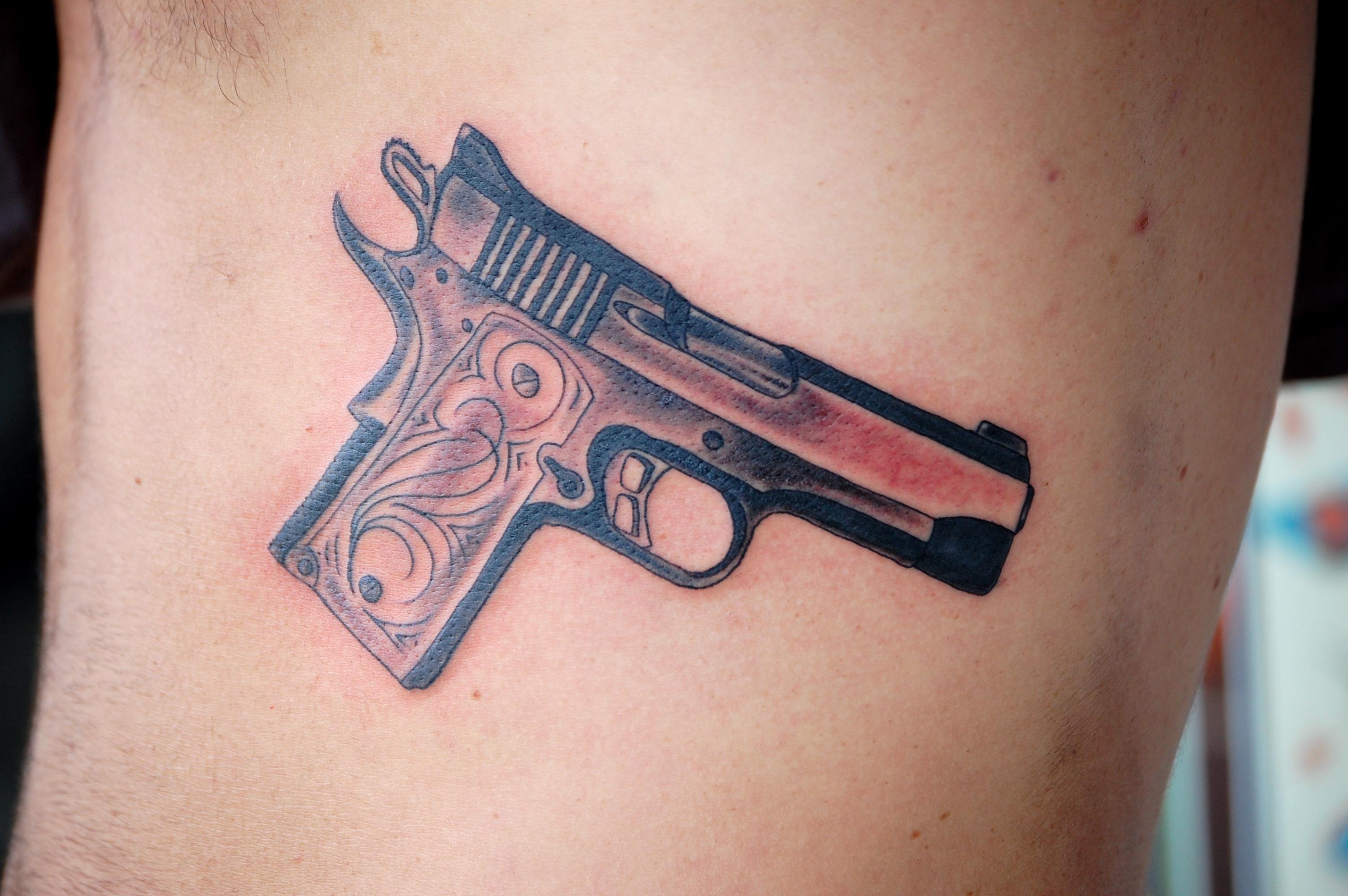 cool gun tattoo i did and head tattoo tattoos by nick kelly